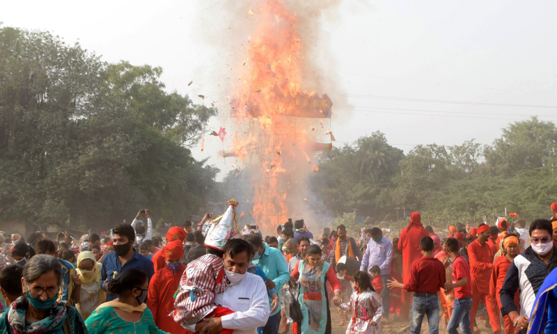 Devotees disperse as an effigy of the Hindu demon King Ravana, stuffed with firecrackers, burns on the occasion of the Hindu festival of Dussehra that marks the triumph of good over evil, in Amritsar on Sunday. — AFP
