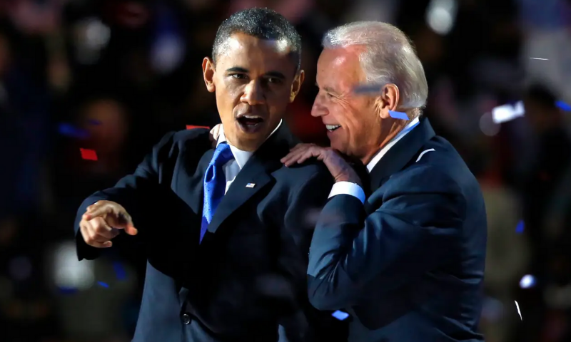Former US President Barack Obama with Joe Biden after his election-night victory speech in Chicago on November 6, 2012. — Reuters