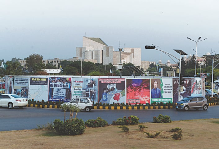 BANNERS installed at Constitution Avenue in Islamabad in connection with black day being observed on Tuesday to express solidarity with Kashmiris in India-held Kashmir.—Mohammad Asim