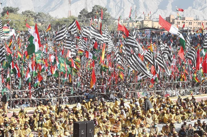 Supporters of PDM wave party flags at the Quetta rally on Sunday. — AFP/File