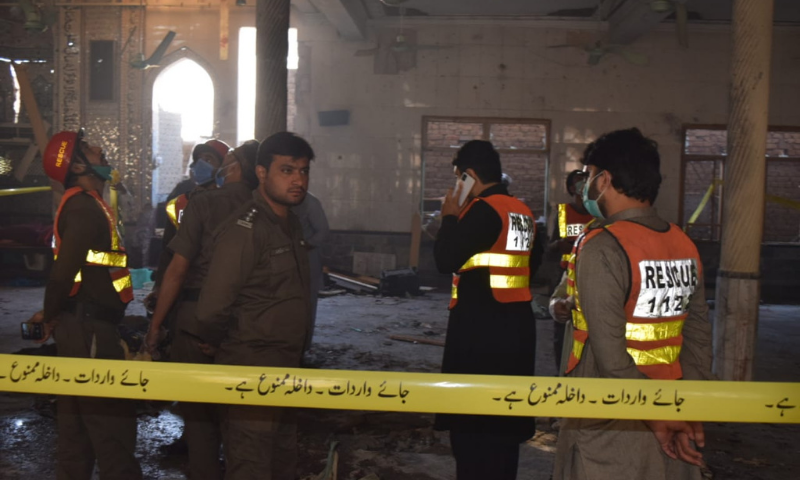 Police and rescue officials are seen at the site of the blast. — Sirajuddin