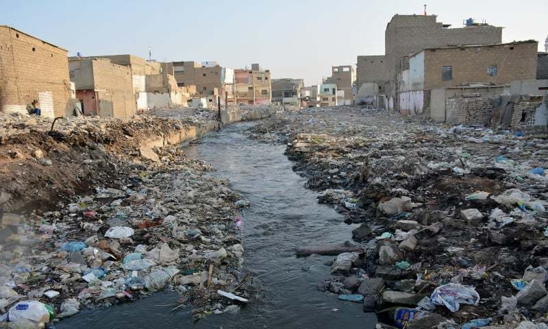 This file photo shows the state of a stormwater drain in Karachi. — Amir Guriro/File