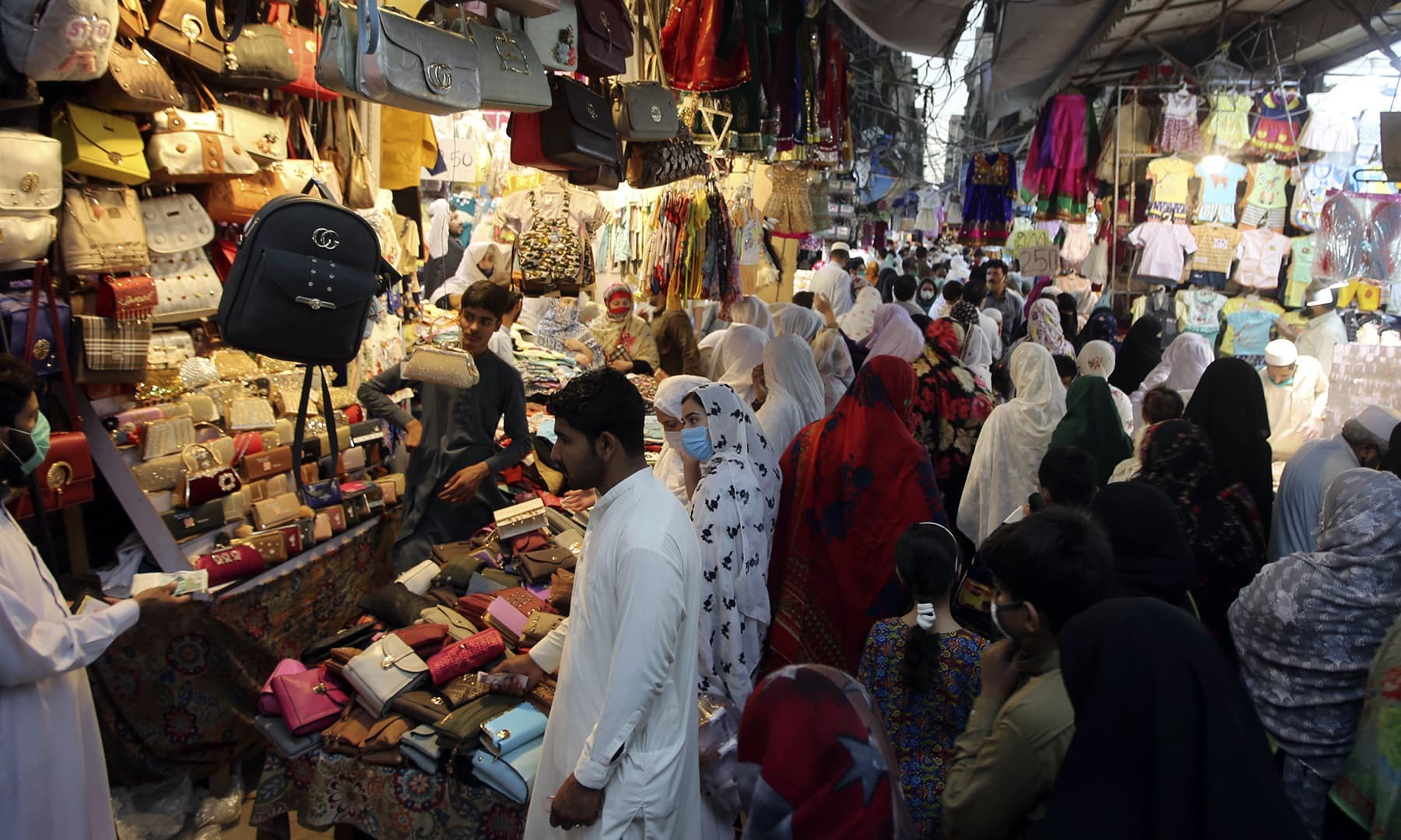 People shop in a market after the government relaxed the weeks-long lockdown in Peshawar in May. — AP/File