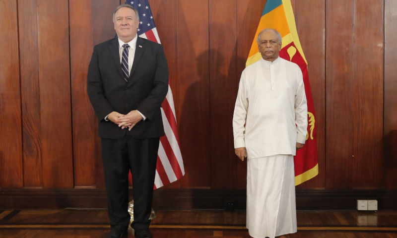 US Secretary of State Mike Pompeo and Sri Lankan Foreign Minister Dinesh Gunawardena stand for photographs before their meeting in Colombo, Sri Lanka on Wednesday.  — AP