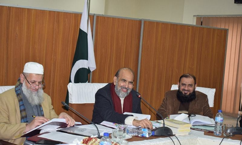 In this file photo, CII Chairman Dr Qibla Ayaz (centre) addresses a press conference. — Photo provided by Javed Hussain