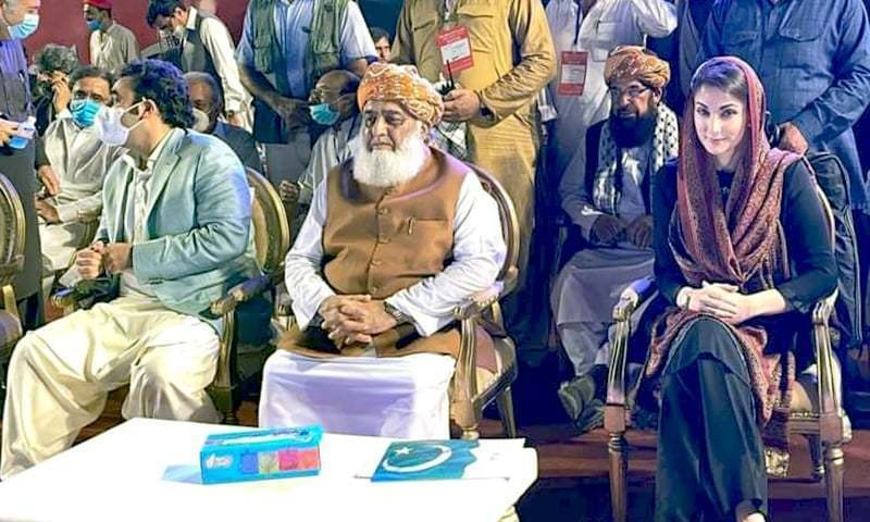 PPP chief Bilawal Bhutto-Zardari, JUI-F chairperson Fazlur Rehman and PML-N vice president Maryam Nawaz seated on a stage set up at Karachi's Bagh-i-Jinnah, the venue of PDM's second rally. — Photo courtesy Twitter/File