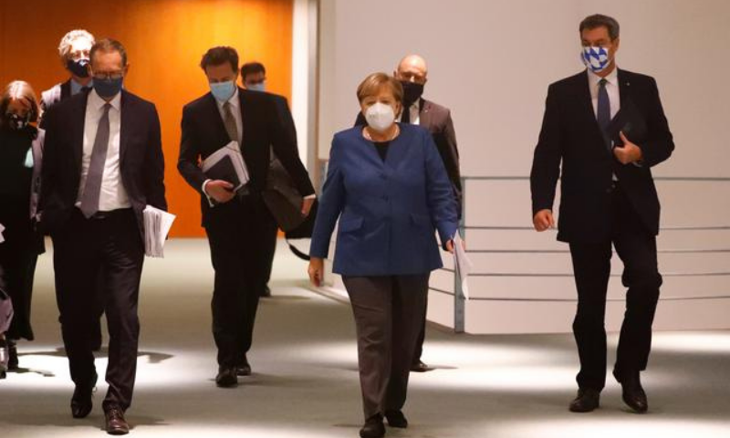 German Chancellor Angela Merkel, Bavarian Prime Minister Markus Soeder and Berlin's mayor Michael Mueller arrive for a news conference at the Chancellery in Berlin, Germany on Oct 28. — Reuters/File
