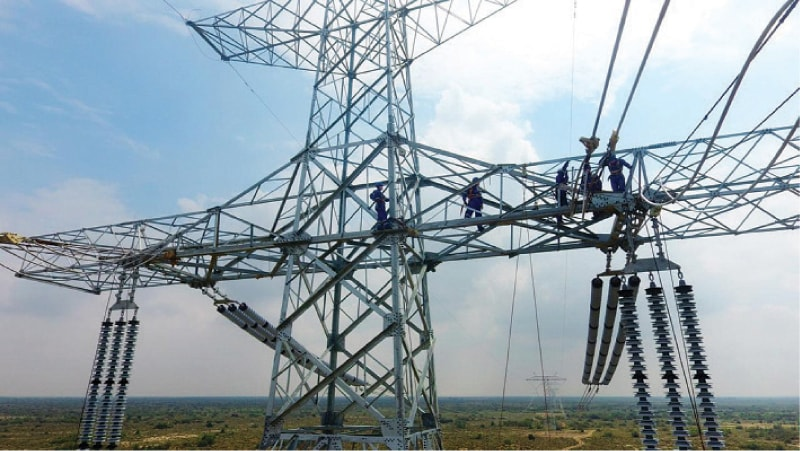 Hasilpur: Hardware installation work at the Matiari-Lahore transmission line is in final stage in Bahawalpur district. The $1.68bn project is the first HVDC project in the country and the second in the world.—Dawn
