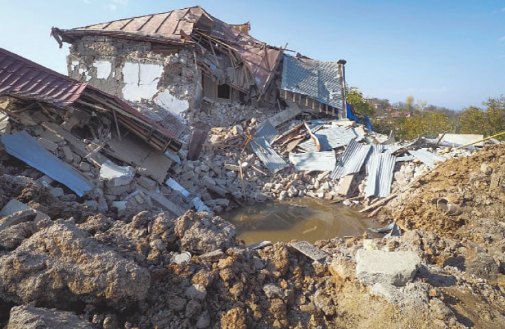Shusha: A bomb crater near a house destroyed during shelling by Azerbaijan's forces on Thursday.—AP