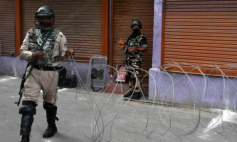 In this file photo, Indian paramilitary trooper block a road during restrictions imposed in various parts of the city to foil Muharram processions at Zadibal area in Srinagar on August 30. — AFP/File