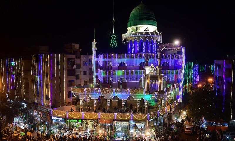 General view of an illuminated mosque and residential apartments ahead of celebrations for Eid-i-Miladun Nabi in Karachi on October 29. — AFP