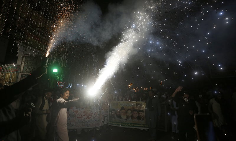 Pakistanis set off fireworks at a rally for Eid-i-Miladun Nabi in Lahore on Oct 29. — AP
