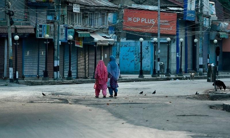 Women walk before a curfew in Srinagar on August 4, 2020. — AFP/File