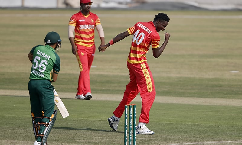 Zimbabwe's bowler Blessing Muzarabani, right, celebrates the dismissal of Pakistani batsman Babar Azam, left, during their 1st one-day international cricket match at the Pindi Cricket Stadium on October 30. — AP