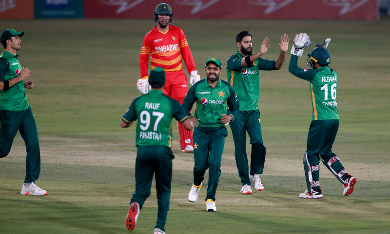 Pakistan spinner Imad Wasim (2R), celebrates with teammates after taking the wicket of Zimbabwe's batsman Craig Ervine during their 1st one-day international cricket match at the Pindi Cricket Stadium, in Rawalpindi, Pakistan on October 30, 2020.— AP