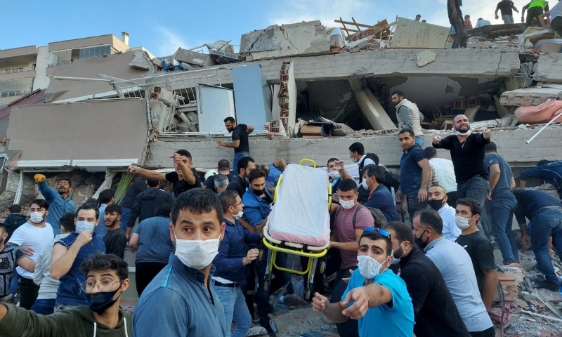 Locals and officials search for survivors at a collapsed building after a strong earthquake struck the Aegean Sea on Friday and was felt in both Greece and Turkey, where some buildings collapsed in the coastal province of Izmir, Turkey on October 30, 2020. — Reuters