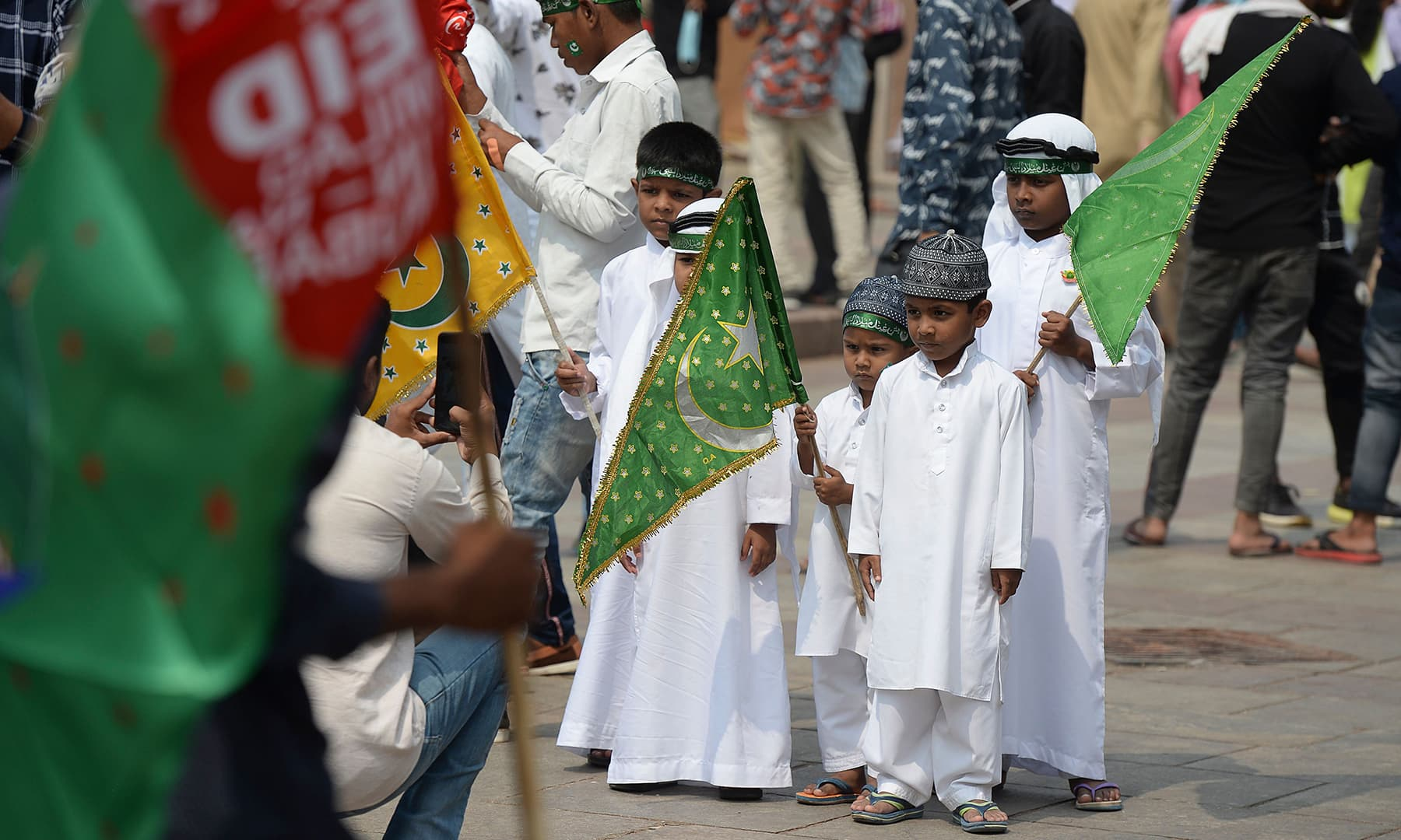 Muslim devotees take pictures as they participate in a procession during Eid-i-Miladun Nabi in Hyderabad, India on October 30. — AFP
