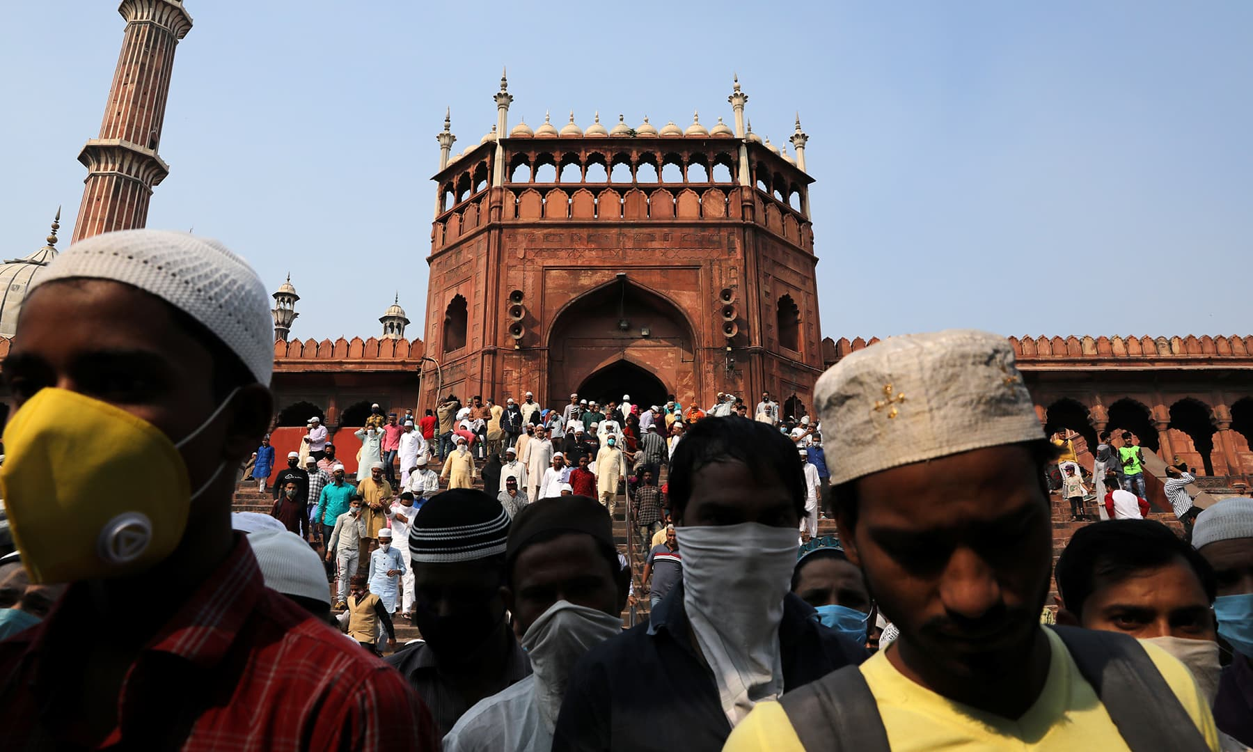 Muslims wearing protective face masks leave Jama Masjid after offering Friday prayers on the occasion of Eid-i-Miladun Nabi in the old quarters of Delhi, India, Oct 30. — Reuters