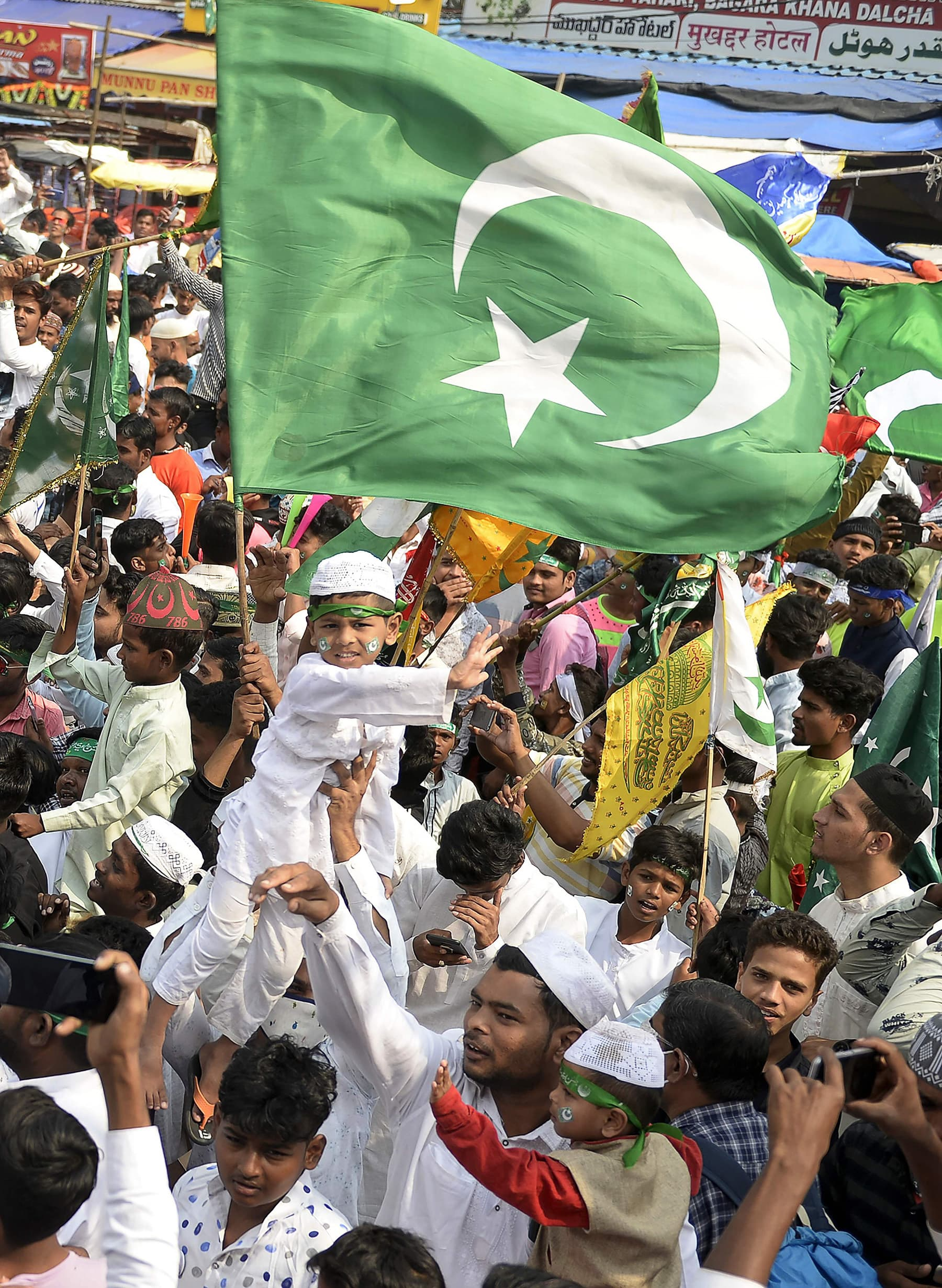 Devotees participate in a procession during Eid-i-Miladun Nabi in Hyderabad, India on October 30. — AFP