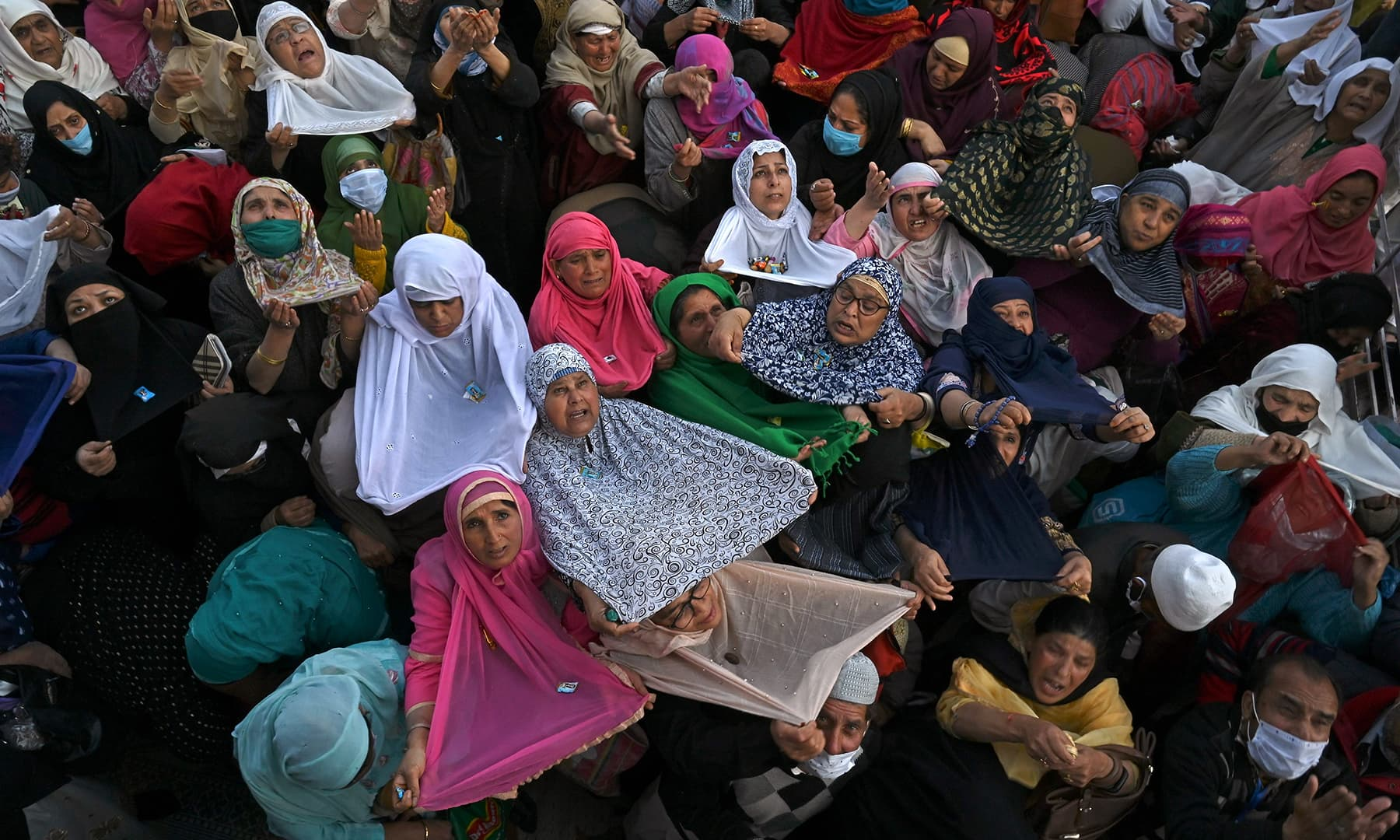 Devotees react during Eid-i-Miladun Nabi celebration at the Hazratbal Shrine in Srinagar, Indian-occupied Kashmir on October 30. — AFP