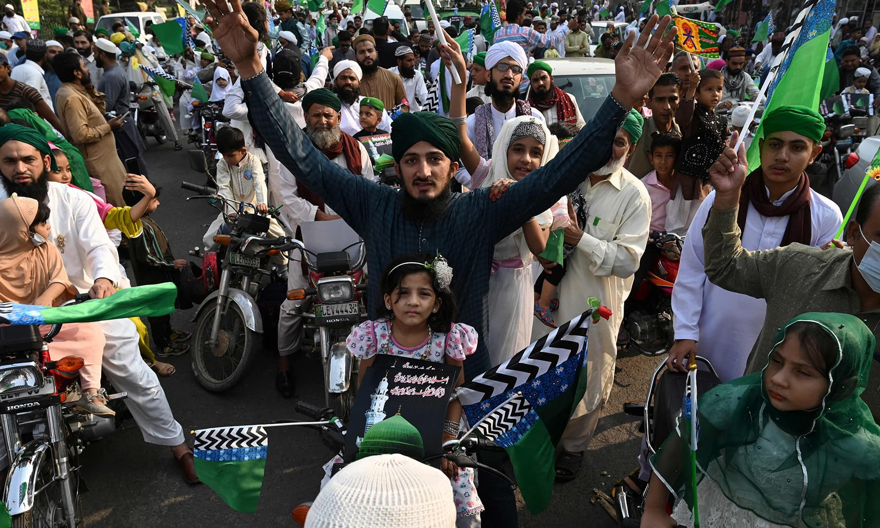 Devotees march during a rally to celebrate the birth anniversary of Prophet Muhammad (PBUH) in Lahore. — AFP