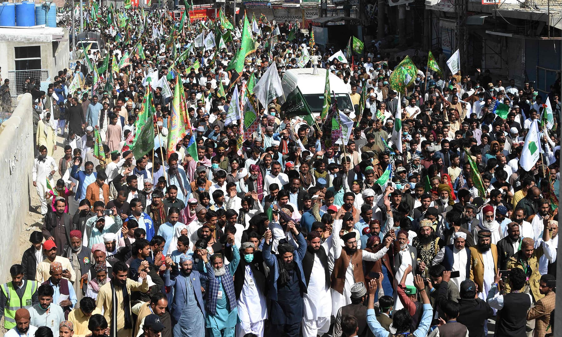 Participants march during a rally to celebrate Eid-i-Miladun Nabi in Quetta on October 30. — AFP