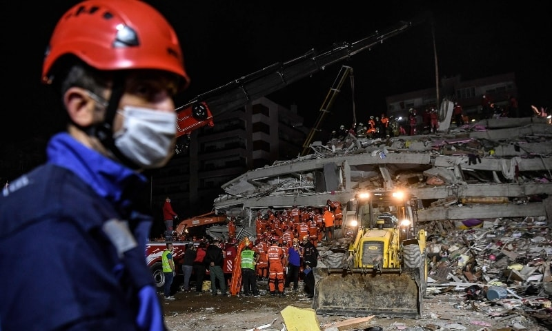 Rescuers search for survivors among the rubble of a collapsed building after a powerful earthquake struck Turkey's western coast and parts of Greece, in Izmir, on October 30. —  AFP