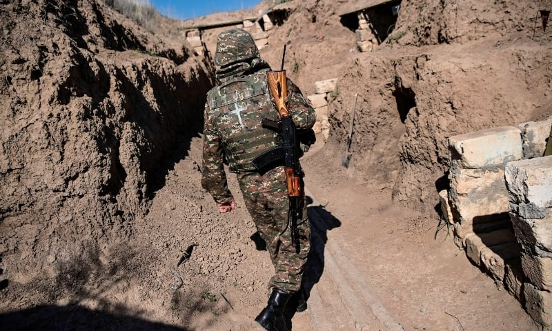 In this file photo taken on October 25, an Armenian soldier walks as troops hold positions on the front line during the ongoing fighting between Armenian and Azerbaijani forces over the breakaway region of Nagorno-Karabakh. — AFP