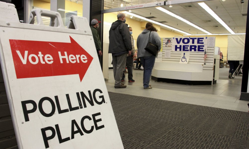 Residents in Anchorage, Alaska, take part in early voting in a mall in Alaska's largest city on Friday. — AP
