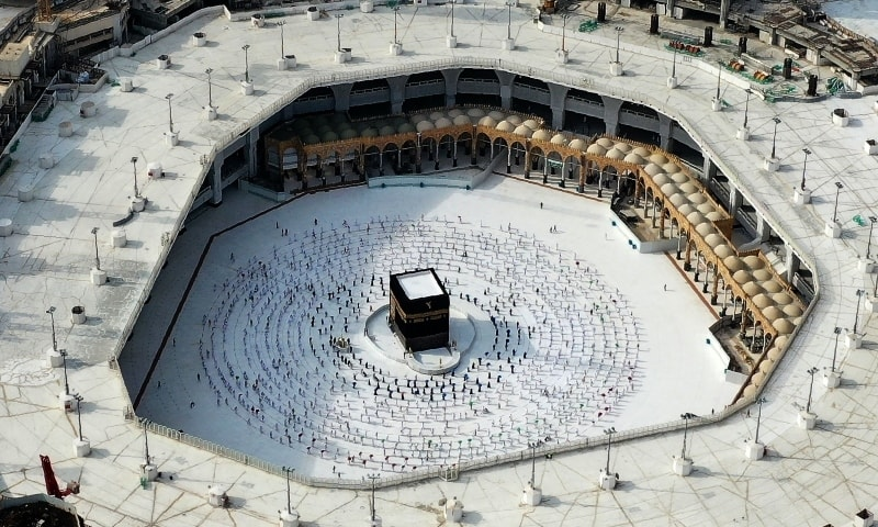 This file aerial view taken on July 31, 2020, shows pilgrims circumambulating (Tawaf Al-Ifada) around the Kaaba, in the Grand Mosque in Saudi Arabia's holy city of Makkah. — AFP
