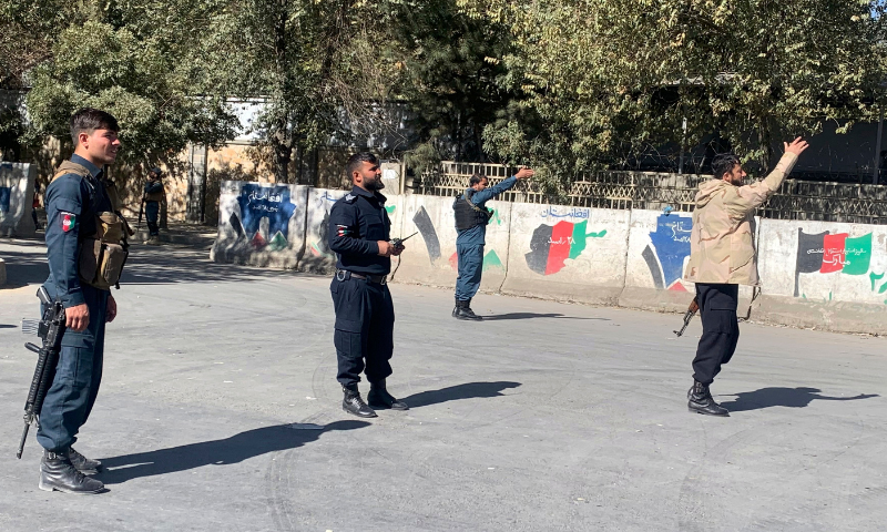 Afghan police arrive at the site of an attack at Kabul University in Kabul, Afghanistan on Monday. — AP