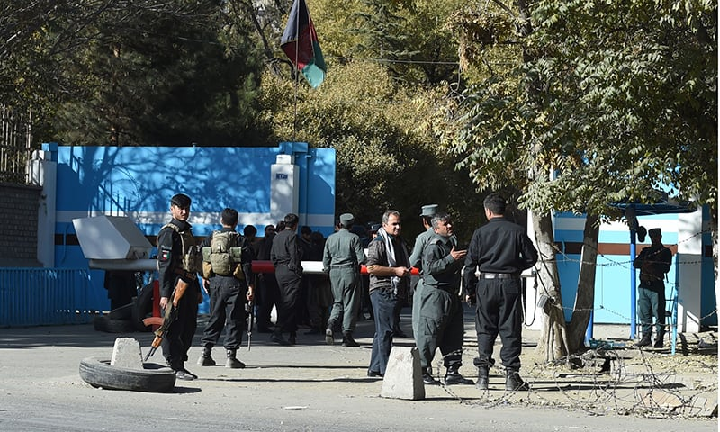 Policemen stand guard at an entrance gate of the Kabul University in Kabul on November 2. — AFP