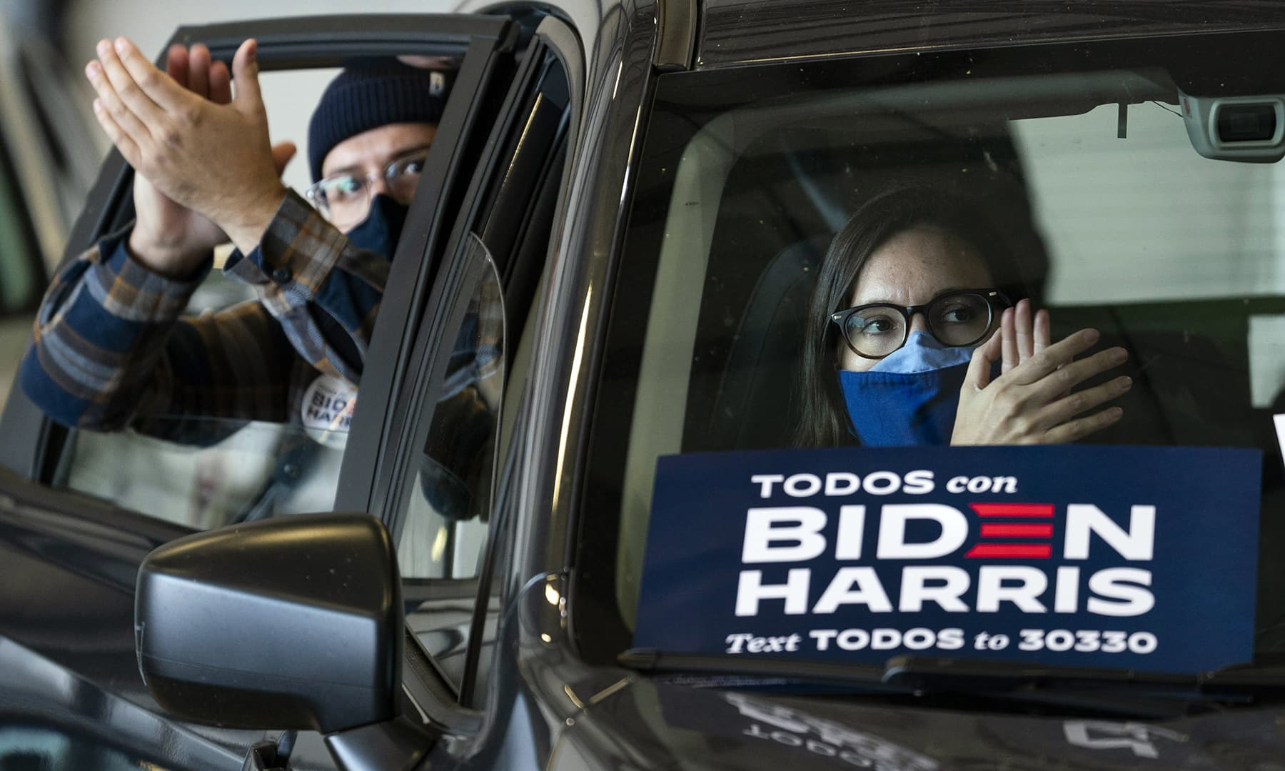 Supporters listen from their cars as Democratic presidential nominee Joe Biden speaks at a get-out-the-vote drive-in rally at Cleveland Burke Lakefront Airport on November 02 in Cleveland, Ohio. — AFP