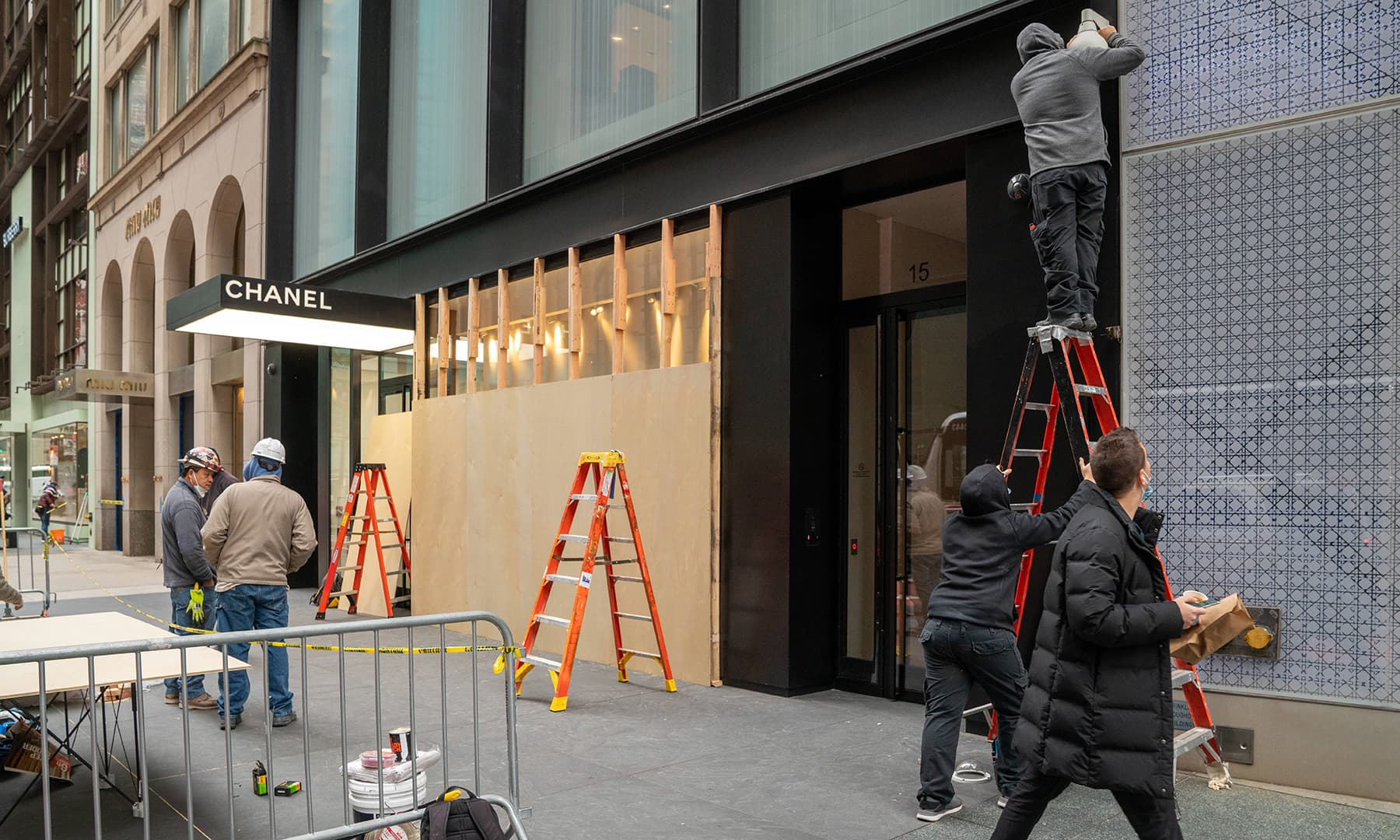 Workers board up a Chanel store in anticipation of unrest related to the presidential election on November 2 in New York City. — AFP