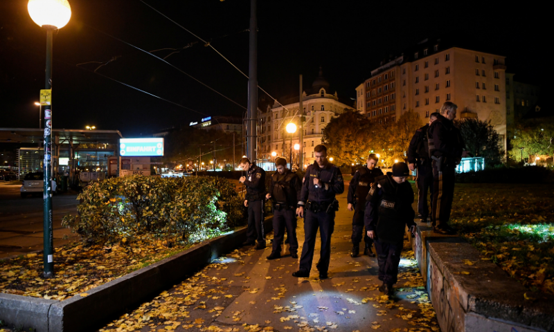Police officers search in an area after exchanges of gunfire in Vienna, Austria. — Reuters