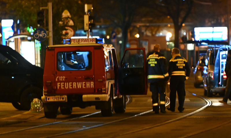 Firefighters and police cars stand near Schwedenplatz square following a shooting in the center of Vienna on November 2. — AFP