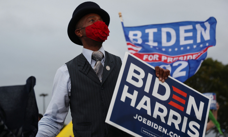 Jon Saxx waits for the arrival of former President Barack Obama for his drive-in campaign rally in support of Democratic presidential nominee Joe Biden on Nov 2 in Miami, Florida. — AFP
