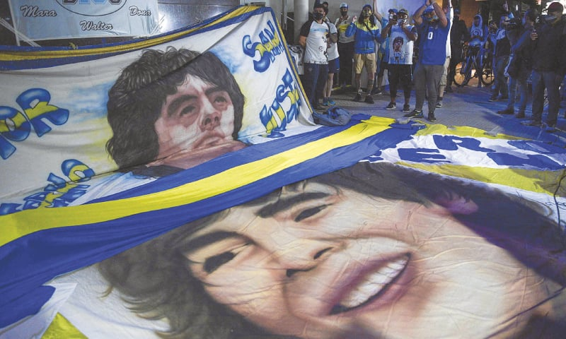 BUENOS AIRES: Supporters of Diego Maradona gather outside the hospital. — AFP
