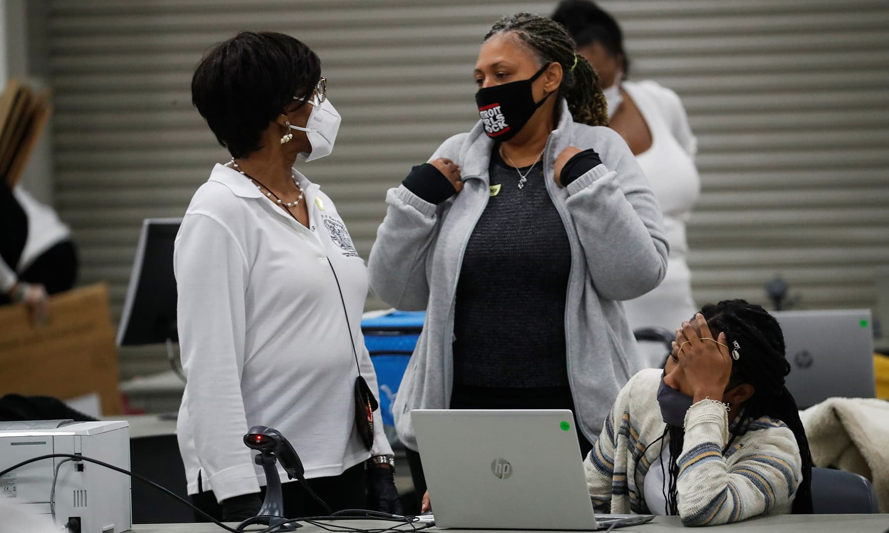 Poll workers speak as votes continue to be counted at the TCF Centre the day after the 2020 US presidential election, in Detroit, on November 4. — Reuters