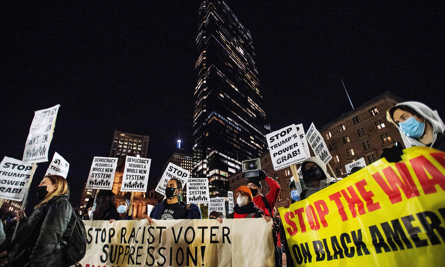 People gather at Copley Square at the Boston Public Library calling for a new political party and system, not happy with either political candidate, in Boston on November 4. — AFP