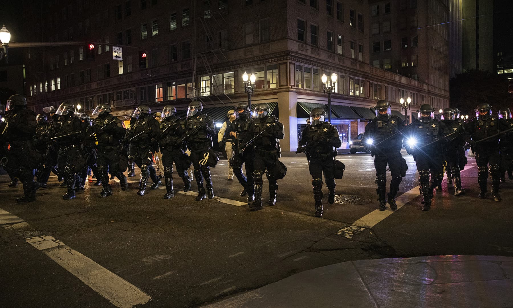Police form a a perimeter during protests following the November 3 presidential election in Portland on November 4. — AP