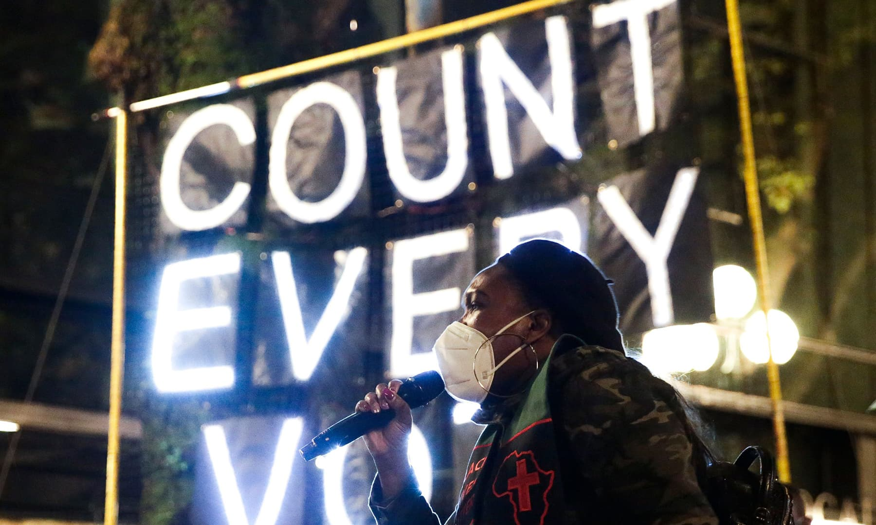 """Reverend Bianca Davis-Lovelace speaks at a rally and march to """"Count Every Vote, Protect Every Person"""" in Seattle, Washington on November 4. — AFP"""