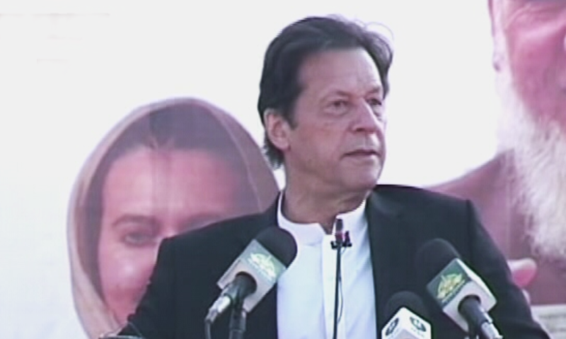 Prime Minister Imran Khan speaks at a ceremony after inaugurating the Sehat Sahulat Cards programme in Swat on Friday. — DawnNewsTV