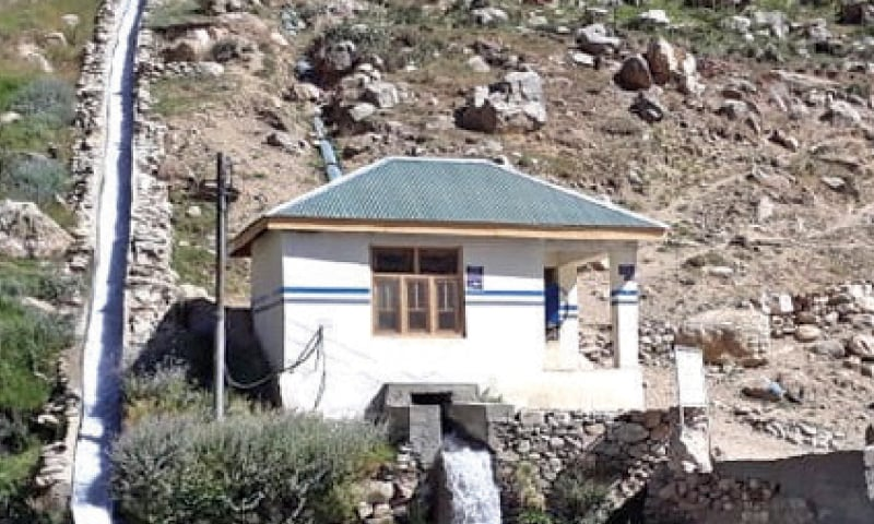 A micro hydropower station in Sor Laspur valley. — Dawn