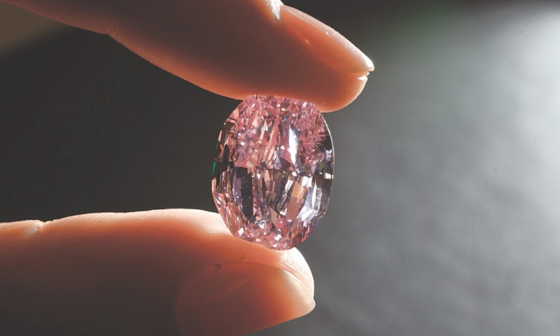 GENEVA: The rare vivid purple pink diamond during a press preview before its sale by Sotheby's.—AFP