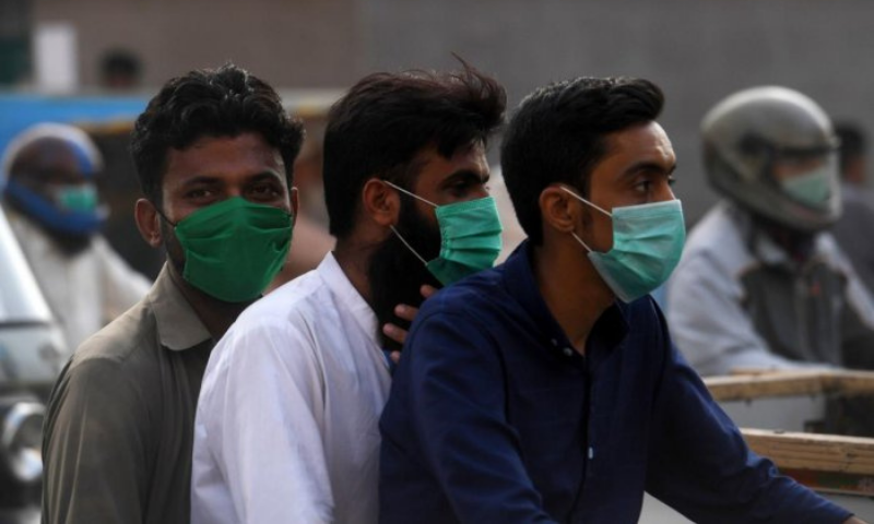 In view of a surge in coronavirus cases during the second wave of the viral disease in the country, the National Command and Operation Centre (NCOC) on Friday issued new guidelines, including fixing Rs100 as fine for not wearing mask. — AFP/File