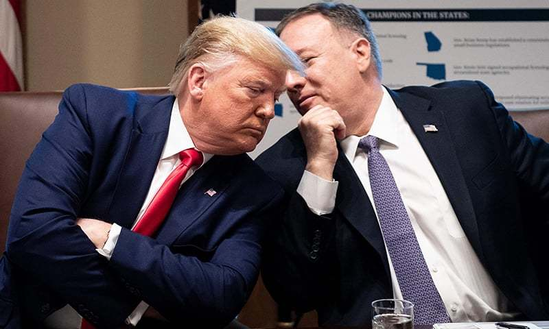 In this file photo taken on October 21, 2019, US President Donald Trump (L) listens to US Secretary of State Mike Pompeo during a Cabinet Meeting at the White House in Washington, DC. — AFP/File