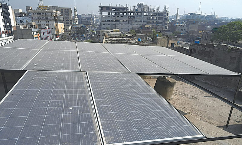 LAHORE: Solar panels are installed at the rooftop of a hotel near Lakshmi Chowk.  — Arif Ali / White Star