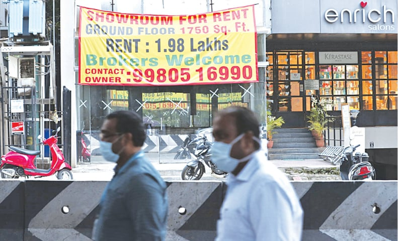 A banner advertising the availability of commercial property is displayed after it was vacated recently due to the coronavirus pandemic in Bengaluru. — AP