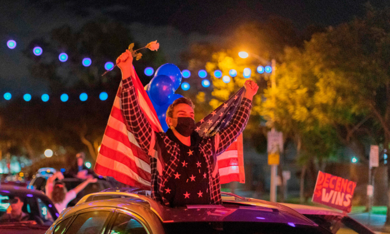 People celebrate the victory of Joe Biden in the 2020 presidential election in West Hollywood, California, on Nov 7. — AFP